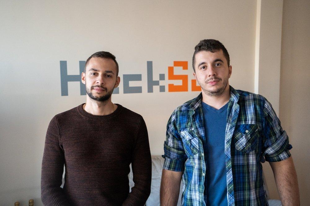 Ivo & Rado in front of HackSoft logo